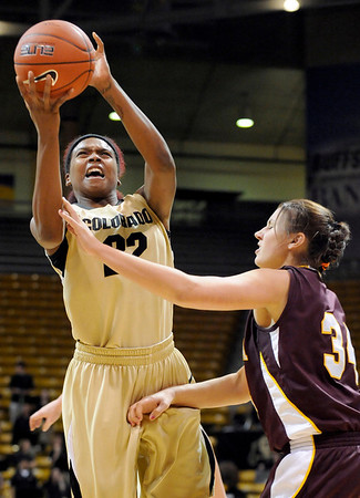 """University of Colorado senior Brittany Spears drives the ball past Loyola sophomore Abby Skube on Saturday, Nov. 27, during a basketball game against Loyola University Chicago at the Coors Events Center on the CU campus. CU defeated Loyola 65-34.<br /> For more photos go to  <a href=""""http://www.dailycamera.com"""">http://www.dailycamera.com</a><br /> Photo by Jeremy Papasso"""