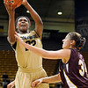 "University of Colorado senior Brittany Spears drives the ball past Loyola sophomore Abby Skube on Saturday, Nov. 27, during a basketball game against Loyola University Chicago at the Coors Events Center on the CU campus. CU defeated Loyola 65-34.<br /> For more photos go to  <a href=""http://www.dailycamera.com"">http://www.dailycamera.com</a><br /> Photo by Jeremy Papasso"
