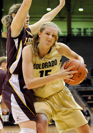 "University of Colorado junior Julie Seabrook drives towards the hoop on Saturday, Nov. 27, during a basketball game against Loyola University Chicago at the Coors Events Center on the CU campus. CU defeated Loyola 65-34.<br /> For more photos go to  <a href=""http://www.dailycamera.com"">http://www.dailycamera.com</a><br /> Photo by Jeremy Papasso"