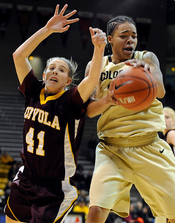 """University of Colorado sophomore Chucky Jeffery grabs the rebound over Loyola junior Katie Kortekamp on Saturday, Nov. 27, during a basketball game against Loyola University Chicago at the Coors Events Center on the CU campus. CU defeated Loyola 65-34.<br /> For more photos go to  <a href=""""http://www.dailycamera.com"""">http://www.dailycamera.com</a><br /> Photo by Jeremy Papasso"""