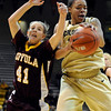 "University of Colorado sophomore Chucky Jeffery grabs the rebound over Loyola junior Katie Kortekamp on Saturday, Nov. 27, during a basketball game against Loyola University Chicago at the Coors Events Center on the CU campus. CU defeated Loyola 65-34.<br /> For more photos go to  <a href=""http://www.dailycamera.com"">http://www.dailycamera.com</a><br /> Photo by Jeremy Papasso"