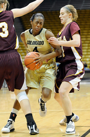 """University of Colorado senior Britney Blythe goes for a layup on Saturday, Nov. 27, during a basketball game against Loyola University Chicago at the Coors Events Center on the CU campus. CU defeated Loyola 65-34.<br /> For more photos go to  <a href=""""http://www.dailycamera.com"""">http://www.dailycamera.com</a><br /> Photo by Jeremy Papasso"""