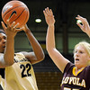 "University of Colorado senior Brittany Spears drives the ball past Loyola senior Brittany Boeke on Saturday, Nov. 27, during a basketball game against Loyola University Chicago at the Coors Events Center on the CU campus. CU defeated Loyola 65-34.<br /> For more photos go to  <a href=""http://www.dailycamera.com"">http://www.dailycamera.com</a><br /> Photo by Jeremy Papasso"