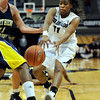 "University of Colorado's Brittany Wilson passes the ball to a teammate during a game against Northern Arizona on Friday, Nov. 11, at the Coors Event Center on the CU campus in Boulder. CU won the game 84-60. For more photos of the game go to  <a href=""http://www.dailycamera.com"">http://www.dailycamera.com</a><br /> Jeremy Papasso/ Camera"