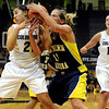 "University of Colorado's Jasmine Sborov, left, fights for the ball with Northern Arizona's Katie Pratt during a game against Northern Arizona on Friday, Nov. 11, at the Coors Event Center on the CU campus in Boulder. CU won the game 84- 60. For more photos of the game go to  <a href=""http://www.dailycamera.com"">http://www.dailycamera.com</a><br /> Jeremy Papasso/ Camera"