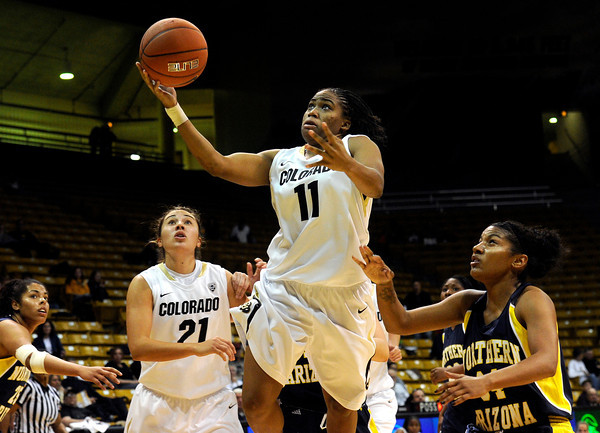 "University of Colorado's Brittany Wilson goes for a lay up during a game against Northern Arizona on Friday, Nov. 11, at the Coors Event Center on the CU campus in Boulder. CU won the game 84-60. For more photos of the game go to  <a href=""http://www.dailycamera.com"">http://www.dailycamera.com</a><br /> Jeremy Papasso/ Camera"