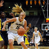 "University of Colorado's Julie Seabrook drives the ball past Northern Arizona's Trinidee Trice during a game against Northern Arizona on Friday, Nov. 11, at the Coors Event Center on the CU campus in Boulder. CU won the game 84- 60. For more photos of the game go to  <a href=""http://www.dailycamera.com"">http://www.dailycamera.com</a><br /> Jeremy Papasso/ Camera"