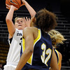 "University of Colorado's Jen Reese takes a shot over Northern Arizona's Amy Patton during a game against Northern Arizona on Friday, Nov. 11, at the Coors Event Center on the CU campus in Boulder. CU won the game 84- 60. For more photos of the game go to  <a href=""http://www.dailycamera.com"">http://www.dailycamera.com</a><br /> Jeremy Papasso/ Camera"