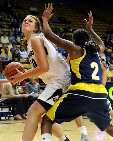 "University of Colorado's Rachel Hargis drives past Northern Arizona's Shay May during a game against Northern Arizona on Friday, Nov. 11, at the Coors Event Center on the CU campus in Boulder. CU won the game 84-60. For more photos of the game go to  <a href=""http://www.dailycamera.com"">http://www.dailycamera.com</a><br /> Jeremy Papasso/ Camera"