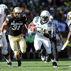 "Kenjon Barner of Oregon runs ahead of Jon Major of CU.<br /> For more photos of the game, go to  <a href=""http://www.dailycamera.com"">http://www.dailycamera.com</a>.<br /> October 22, 2011 / Cliff Grassmick"