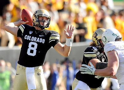 University of Colorado quarterback Nick Hirschman throws a pass on Saturday, Oct. 22, during a football game against the University of Oregon at Folsom Field in Boulder. For more photos go to www.dailycamera.com Jeremy Papasso/ Camera