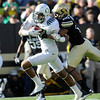 "Brian Teague of Oregon tries to score with Greg Henderson of CU on his back.<br /> For more photos of the game, go to  <a href=""http://www.dailycamera.com"">http://www.dailycamera.com</a>.<br /> October 22, 2011 / Cliff Grassmick"