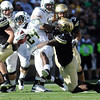 "Derrick Webb of CU tackles Kenjon Barner of Oregon.<br /> For more photos of the game, go to  <a href=""http://www.dailycamera.com"">http://www.dailycamera.com</a>.<br /> October 22, 2011 / Cliff Grassmick"