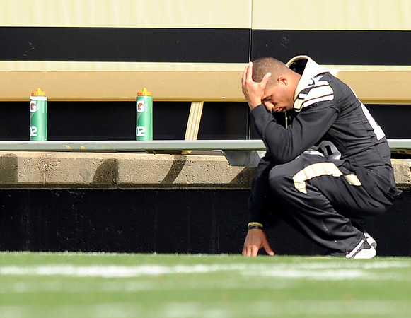 "University of Colorado's Ray Polk shows his disappointment on the sidelines after an Oregon State touchdown in the first quarter on Saturday, Oct. 22, during a football game against the University of Oregon at Folsom Field in Boulder. For more photos go to  <a href=""http://www.dailycamera.com"">http://www.dailycamera.com</a><br /> Jeremy Papasso/ Camera"