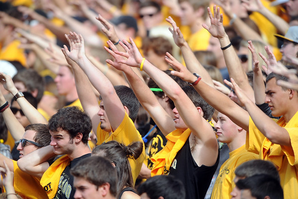"CU fans put their hands up on the kick-off against Oregon.<br /> For more photos of the game, go to  <a href=""http://www.dailycamera.com"">http://www.dailycamera.com</a>.<br /> October 22, 2011 / Cliff Grassmick"