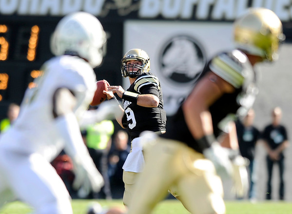 "University of Colorado's Tyler Hansen throws a pass in the first quarter on Saturday, Oct. 22, during a football game against the University of Oregon at Folsom Field in Boulder. CU lost the game 45-2. For more photos go to  <a href=""http://www.dailycamera.com"">http://www.dailycamera.com</a><br /> Jeremy Papasso/ Camera"