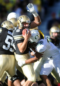 CU QB Nick Hirschman is sacked by Dewitt Stuckey of Oregon in the second half of the Buff loss. For more photos of the game, go to www.dailycamera.com. October 22, 2011 / Cliff Grassmick