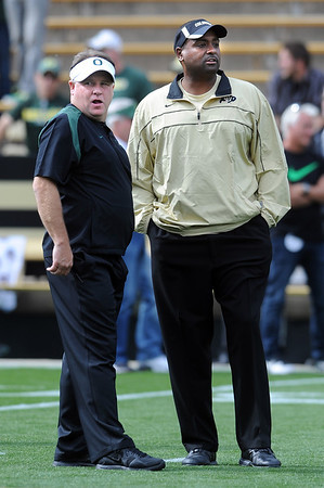 "Head coaches, Chip Kelly, left, of Oregon, and Jon Embree of Colorado before the game.<br /> For more photos of the game, go to  <a href=""http://www.dailycamera.com"">http://www.dailycamera.com</a>.<br /> October 22, 2011 / Cliff Grassmick"