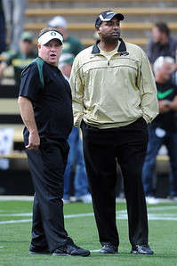 Head coaches, Chip Kelly, left, of Oregon, and Jon Embree of Colorado before the game. For more photos of the game, go to www.dailycamera.com. October 22, 2011 / Cliff Grassmick