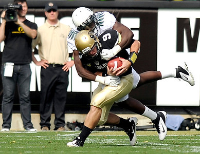 University of Colorado's Tyler Hansen gets sacked by Oregon's Josh Kaddu on Saturday, Oct. 22, during a football game against the University of Oregon at Folsom Field in Boulder. CU lost the game 45-2. For more photos go to www.dailycamera.com Jeremy Papasso/ Camera