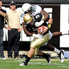 "University of Colorado's Tyler Hansen gets sacked by Oregon's Josh Kaddu on Saturday, Oct. 22, during a football game against the University of Oregon at Folsom Field in Boulder. CU lost the game 45-2. For more photos go to  <a href=""http://www.dailycamera.com"">http://www.dailycamera.com</a><br /> Jeremy Papasso/ Camera"