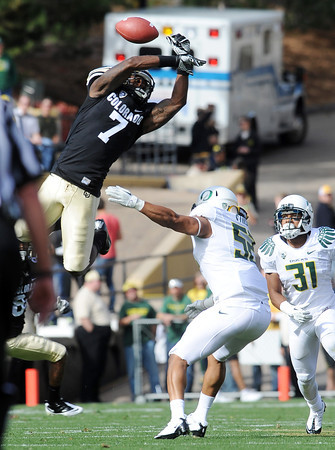 "A high pass gets past Toney Clemons of Colorado against Oregon.<br /> For more photos of the game, go to  <a href=""http://www.dailycamera.com"">http://www.dailycamera.com</a>.<br /> October 22, 2011 / Cliff Grassmick"