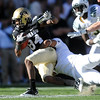 "Keenan Canty of CU tries to escape the Oregon defense.<br /> For more photos of the game, go to  <a href=""http://www.dailycamera.com"">http://www.dailycamera.com</a>.<br /> October 22, 2011 / Cliff Grassmick"
