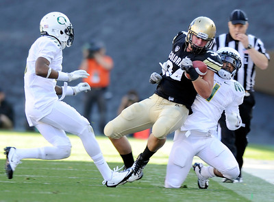 University of Colorado's Ryan Deehan is tackled by Oregon's Erick Dargan on Saturday, Oct. 22, during a football game against the University of Oregon at Folsom Field in Boulder. CU lost the game 45-2. For more photos go to www.dailycamera.com Jeremy Papasso/ Camera