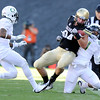 "University of Colorado's Ryan Deehan is tackled by Oregon's Erick Dargan on Saturday, Oct. 22, during a football game against the University of Oregon at Folsom Field in Boulder. CU lost the game 45-2. For more photos go to  <a href=""http://www.dailycamera.com"">http://www.dailycamera.com</a><br /> Jeremy Papasso/ Camera"