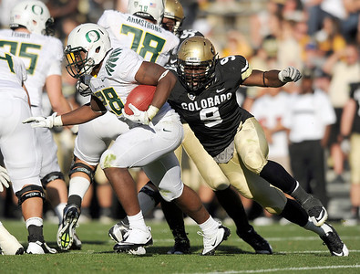 University of Colorado's Chidera Uzo-Diribe attempts to make a tackle on Oregon's Tra Carson on Saturday, Oct. 22, during a football game against the University of Oregon at Folsom Field in Boulder. CU lost the game 45-2. For more photos go to www.dailycamera.com Jeremy Papasso/ Camera