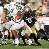 "University of Colorado's Chidera Uzo-Diribe attempts to make a tackle on Oregon's Tra Carson on Saturday, Oct. 22, during a football game against the University of Oregon at Folsom Field in Boulder. CU lost the game 45-2. For more photos go to  <a href=""http://www.dailycamera.com"">http://www.dailycamera.com</a><br /> Jeremy Papasso/ Camera"