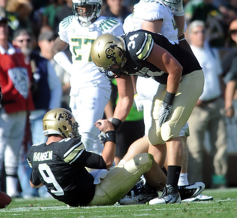 "Ryan Deehan helps Tyler Hansen up after Hansen was hit in a slide attempt. It was thought to be a possible concussion.<br /> For more photos of the game, go to  <a href=""http://www.dailycamera.com"">http://www.dailycamera.com</a>.<br /> October 22, 2011 / Cliff Grassmick"
