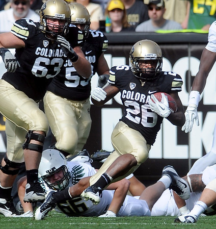 "Tony Jones, of CU, carries the rock against Oregon.<br /> For more photos of the game, go to  <a href=""http://www.dailycamera.com"">http://www.dailycamera.com</a>.<br /> October 22, 2011 / Cliff Grassmick"