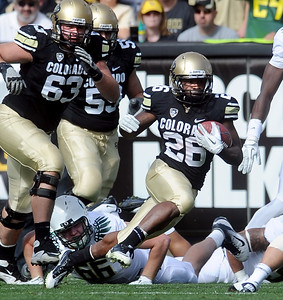 Tony Jones, of CU, carries the rock against Oregon. For more photos of the game, go to www.dailycamera.com. October 22, 2011 / Cliff Grassmick