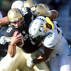 "CU QB Nick Hirschman is sacked by Dewitt Stuckey of Oregon in the second half of the Buff loss.<br /> For more photos of the game, go to  <a href=""http://www.dailycamera.com"">http://www.dailycamera.com</a>.<br /> October 22, 2011 / Cliff Grassmick"