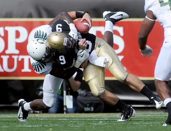 "CU QB Tyler Hansen is sacked by Josh Kaddu in the first half in the Oregon game.<br /> For more photos of the game, go to  <a href=""http://www.dailycamera.com"">http://www.dailycamera.com</a>.<br /> October 22, 2011 / Cliff Grassmick"