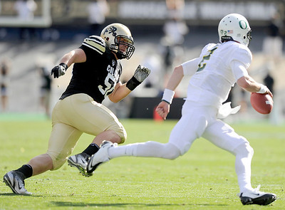 University of Colorado's Curtis Cunningham tries to catch Oregon quarterback Bryan Bennett on Saturday, Oct. 22, during a football game against the University of Oregon at Folsom Field in Boulder. For more photos go to www.dailycamera.com Jeremy Papasso/ Camera