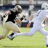 "University of Colorado's Curtis Cunningham tries to catch Oregon quarterback Bryan Bennett on Saturday, Oct. 22, during a football game against the University of Oregon at Folsom Field in Boulder. For more photos go to  <a href=""http://www.dailycamera.com"">http://www.dailycamera.com</a><br /> Jeremy Papasso/ Camera"