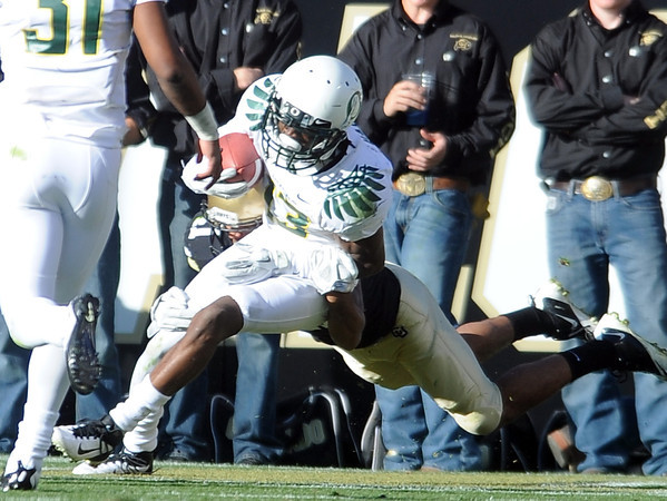 "Cliff Harris of Oregon is tackled in the endzone for a CU safety, the Biffs only score.<br /> For more photos of the game, go to  <a href=""http://www.dailycamera.com"">http://www.dailycamera.com</a>.<br /> October 22, 2011 / Cliff Grassmick"