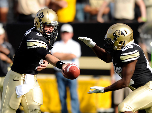 "University of Colorado's Tyler Hansen hands the ball off to Tony Jones on Saturday, Oct. 22, during a football game against the University of Oregon at Folsom Field in Boulder. For more photos go to  <a href=""http://www.dailycamera.com"">http://www.dailycamera.com</a><br /> Jeremy Papasso/ Camera"
