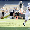 "University of Colorado's K.T. Tu'umalo dives and misses a tackle on Oregon's Tra Carson on Saturday, Oct. 22, during a football game against the University of Oregon at Folsom Field in Boulder. CU lost the game 45-2. For more photos go to  <a href=""http://www.dailycamera.com"">http://www.dailycamera.com</a><br /> Jeremy Papasso/ Camera"