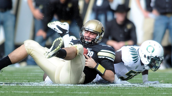 "Tyler Hansen of CU, gets up after a sack by Oregon.<br /> For more photos of the game, go to  <a href=""http://www.dailycamera.com"">http://www.dailycamera.com</a>.<br /> October 22, 2011 / Cliff Grassmick"