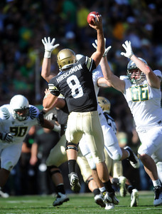 CU QB Nick Hirschman tries to get a pass away under Oregon pressure. For more photos of the game, go to www.dailycamera.com. October 22, 2011 / Cliff Grassmick