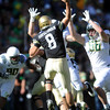 "CU QB Nick Hirschman tries to get a pass away under Oregon pressure.<br /> For more photos of the game, go to  <a href=""http://www.dailycamera.com"">http://www.dailycamera.com</a>.<br /> October 22, 2011 / Cliff Grassmick"