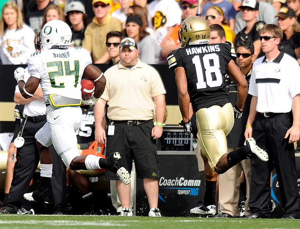 "University of Colorado's Jonathan Hawkins chases after Oregon's Kenjon Barner, who ran the ball in for a touchdown, on Saturday, Oct. 22, during a football game against the University of Oregon at Folsom Field in Boulder. For more photos go to  <a href=""http://www.dailycamera.com"">http://www.dailycamera.com</a><br /> Jeremy Papasso/ Camera"
