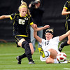 "University of Colorado's  Amy Barczuk goes for a slide tackle on Oregon's Taylor Jones on Sunday, Oct. 16, during a soccer game against Oregon State at Prentup Field on the CU campus in Boulder. For more photos of the game go to  <a href=""http://www.dailycamera.com"">http://www.dailycamera.com</a><br /> Jeremy Papasso/ Camera"