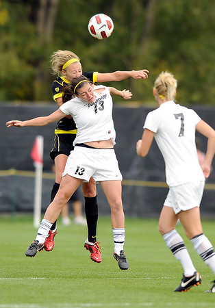"""University of Colorado'sKate Russell tries to head the ball over an Oregon State player on Sunday, Oct. 16, during a soccer game against Oregon State at Prentup Field on the CU campus in Boulder. For more photos of the game go to  <a href=""""http://www.dailycamera.com"""">http://www.dailycamera.com</a><br /> Jeremy Papasso/ Camera"""
