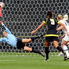 """University of Colorado goalkeeper Annie Brunner dives to stop the ball as Oregon State scored a goal on Sunday, Oct. 16, during a soccer game against Oregon State at Prentup Field on the CU campus in Boulder. For more photos of the game go to  <a href=""""http://www.dailycamera.com"""">http://www.dailycamera.com</a><br /> Jeremy Papasso/ Camera"""