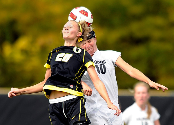 "University of Colorado's Amy Barczuk, right, tries to head the ball over Oregon's Nicole Bakke on Sunday, Oct. 16, during a soccer game against Oregon State at Prentup Field on the CU campus in Boulder. For more photos of the game go to  <a href=""http://www.dailycamera.com"">http://www.dailycamera.com</a><br /> Jeremy Papasso/ Camera"