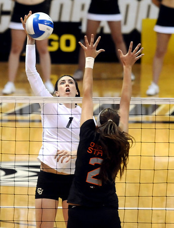 "University of Colorado's Kelsey English goes for a kill on Saturday, Sept. 24, during a volleyball game against the Oregon State Beavers at the Coors Event Center on the CU campus in Boulder. For more photos of the game go to  <a href=""http://www.dailycamera.com"">http://www.dailycamera.com</a><br /> Jeremy Papasso/ Camera"